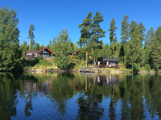 The houses are located by Lake Övre Hillen. The house in the middle of the picture is rented out.  High and open position. Please be free to borrow our rowingboat. We also have bikes to rent.