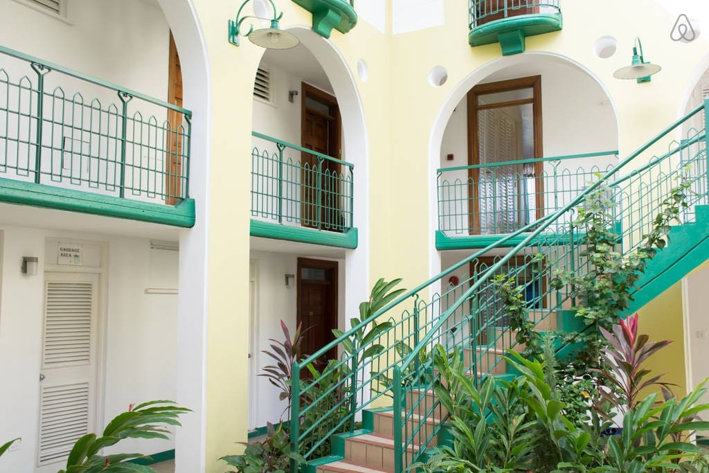 Courtyard View With Staircase Leading Up To Apartment.