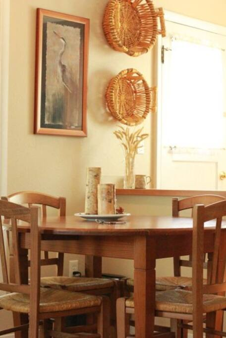 Dining table seats four. The kitchen has everything you need to bake, cook, wine and dine.