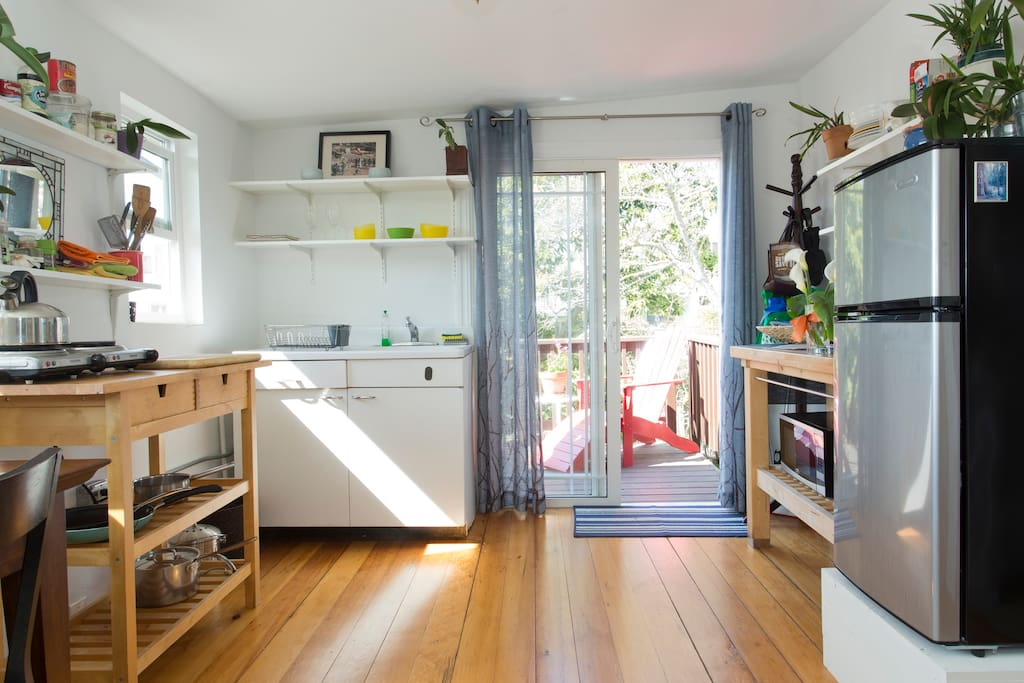 A small but efficient kitchen area looks out into the sun deck and backyard.