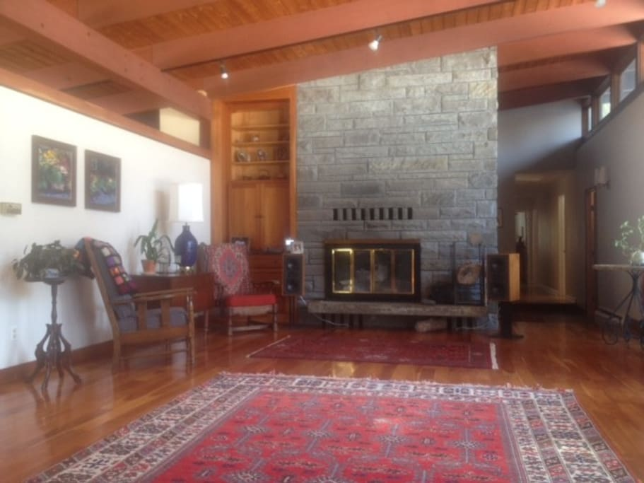 Large shared living room, where we invite you to relax, read a book, or chat with us or cuddle the pets.