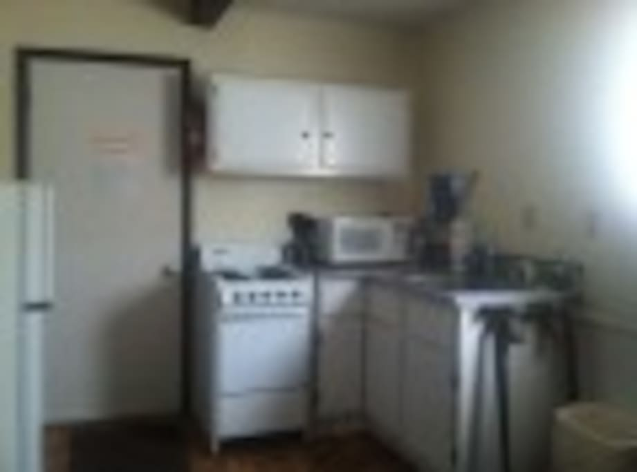 Upgrade/Small Kitchenette Room 11 Sleeps 2-6 King  and 2/Full beds