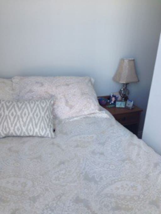 Double bed with pillow-top mattress.
