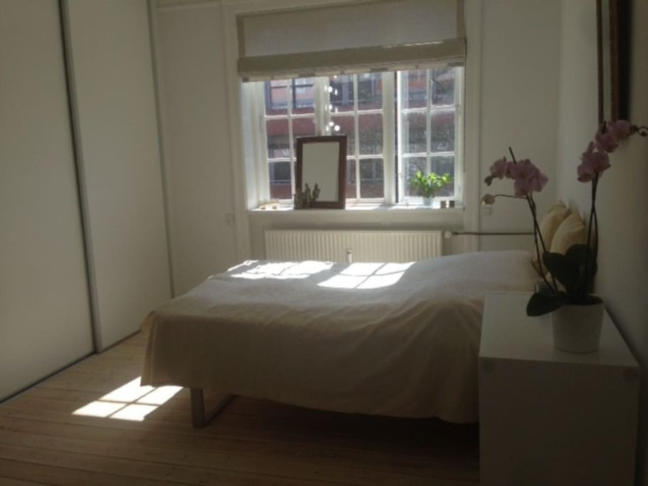 Large and bright bedroom with double bed and lots of space