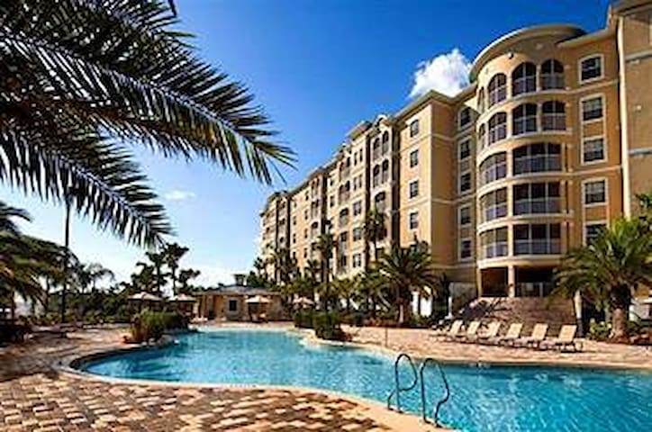 Beautiful exterior with one of four resort pools