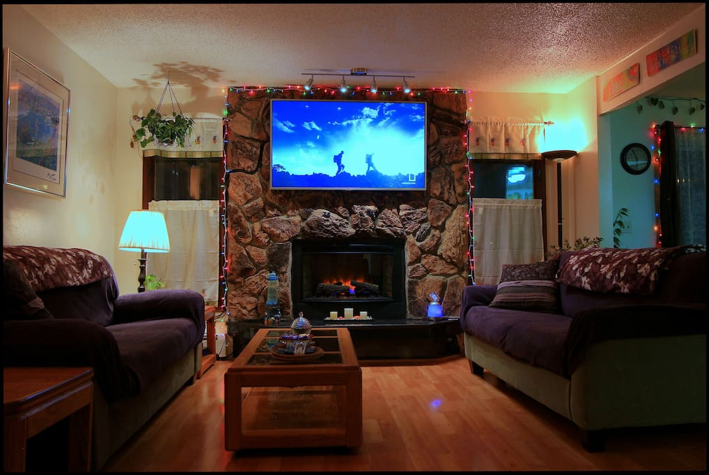 Very spacious living room to enjoy company and movie time with huge flat screen and beautiful fire place