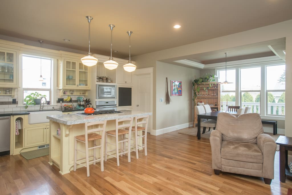 Enjoy the open floor plan connecting dining area, kitchen, and living room.