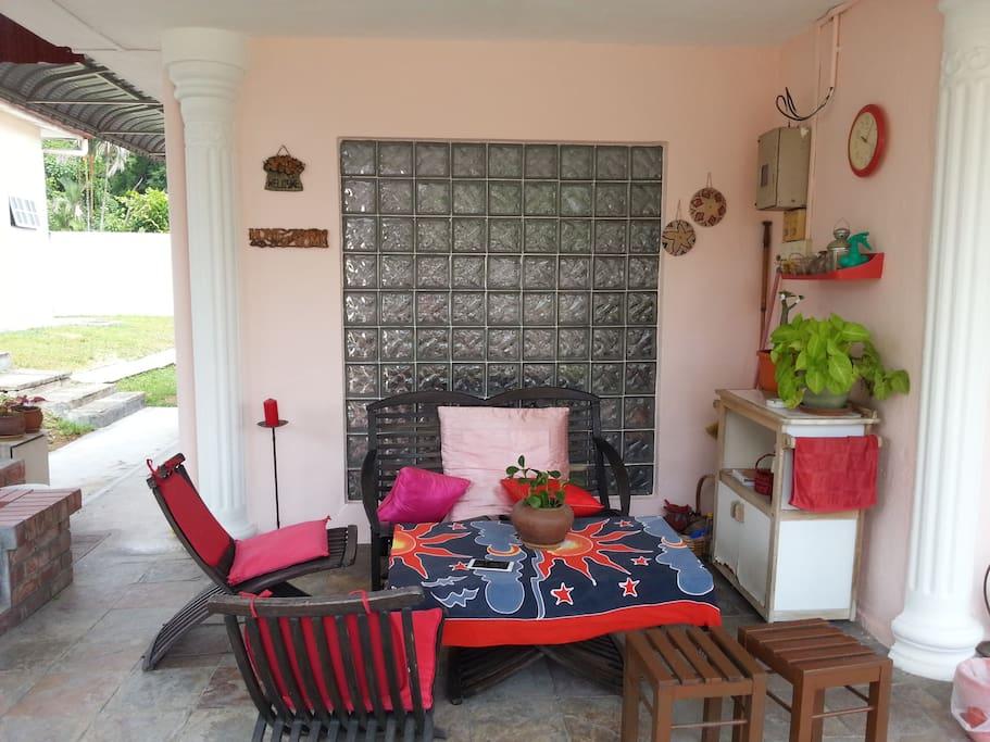 Spacious  verandah outside the garden...have a cuppa of tea outside