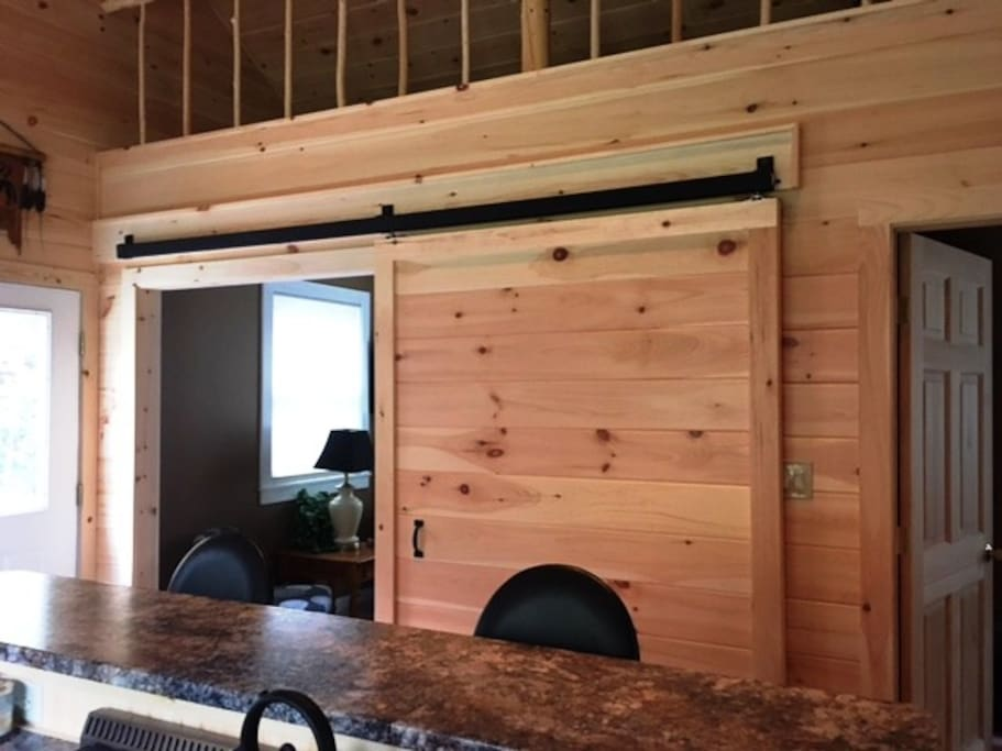 Custom interior with barn door and lots of natural light