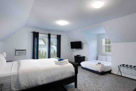 The Peaks I room is large, boasts amazing mountain views from the bed and of all the surrounding peaks from the large, private deck. This room can come with one queen or a queen and extra double bed as pictured here.