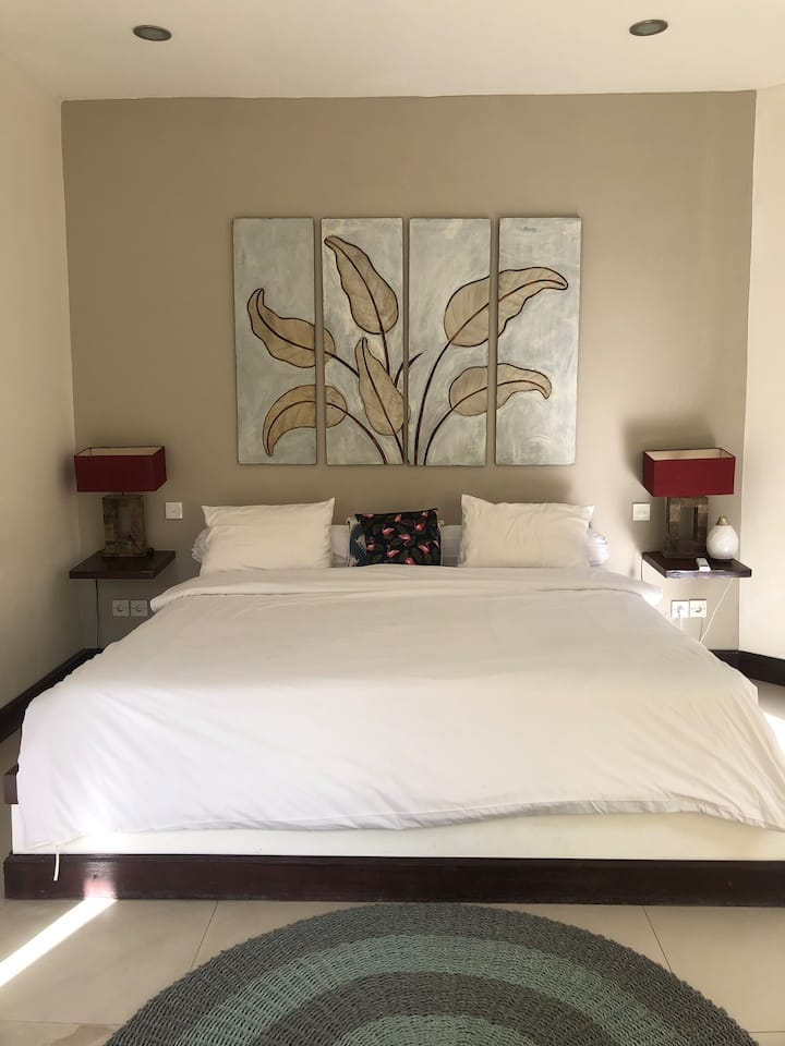 Affordable guest room in tropical villa with pool