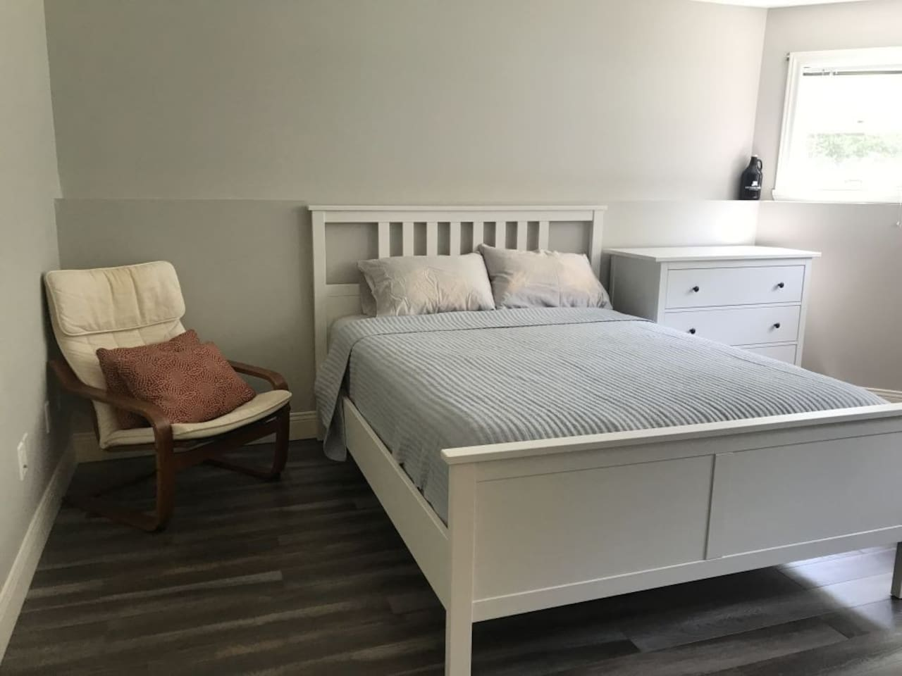 Queen bed with closet and dresser.