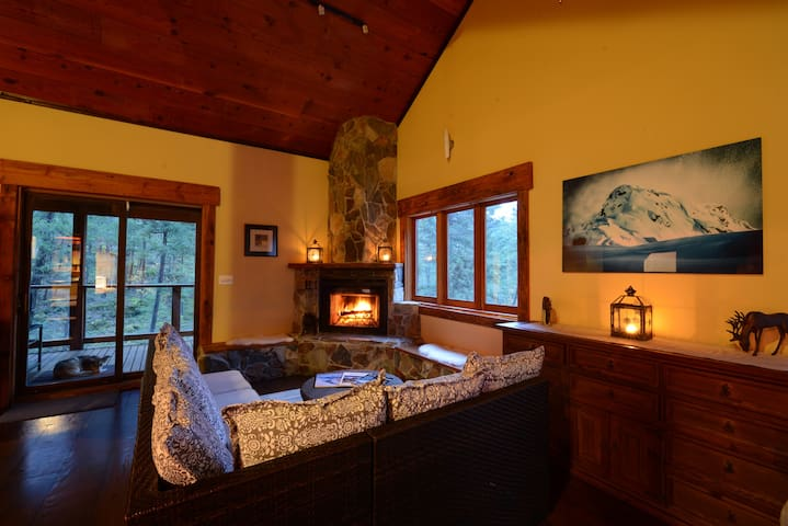 Relax by the warmth of the fire.  this cabin is set in the forest and is very private.