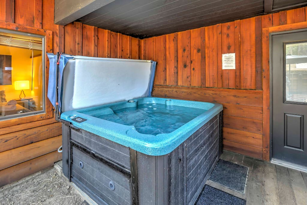 Soak your muscles in the private hot tub after a day of hiking!
