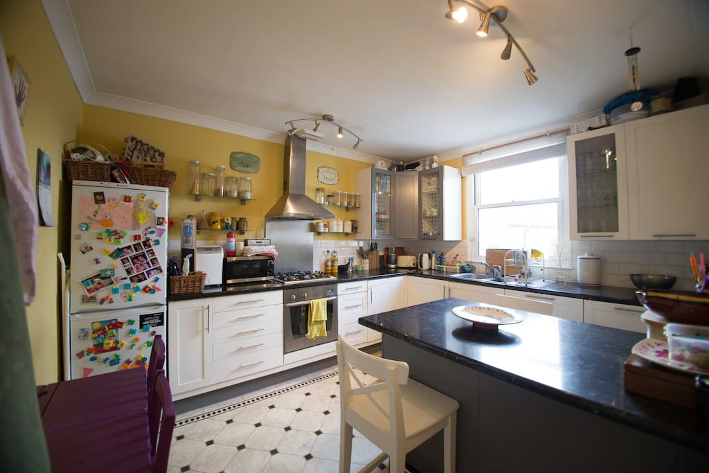 Lovely eat in kitchen, beautiful light in the morning.  Washer, dishwasher, microwave and all the usuals - pots, pans etc