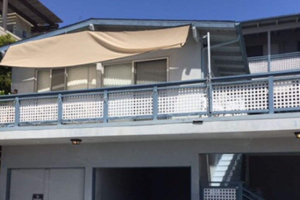 View of the balcony and swing from the street