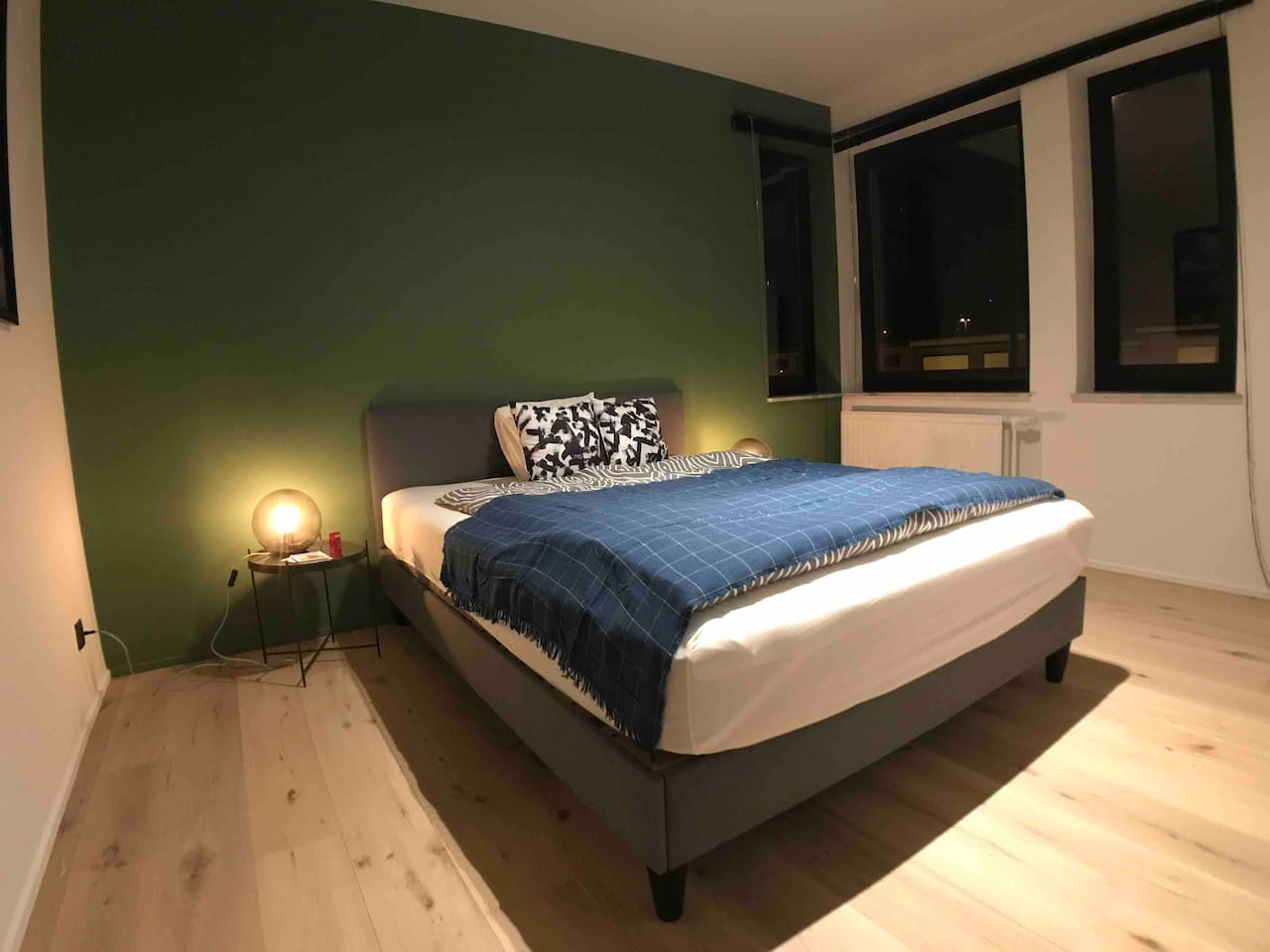 This is your room where you can enjoy staying in my place. It is furnished with a queen size bed, two small tables, two lamps, big wardrobe and couple of souvenirs. It is oriented toward the east with big windows where the sun warms it every morning.