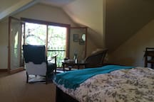 Treetop bedroom and sitting room overlooking the pool
