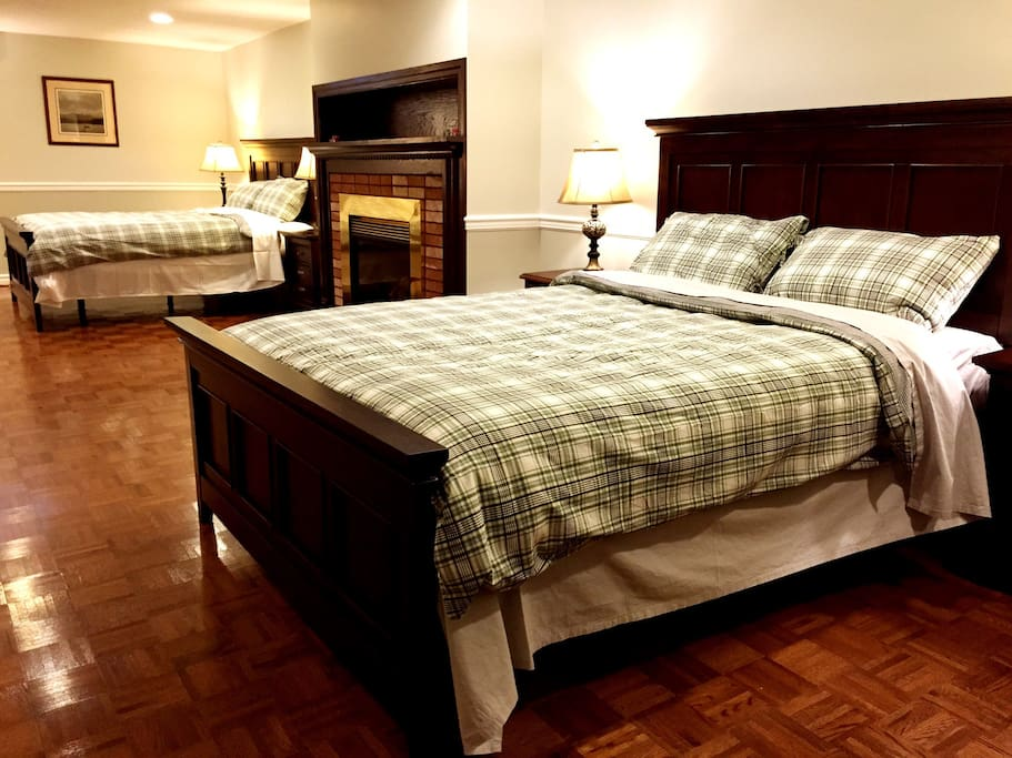 Beautiful biggest bedroom with two queen size bed, living room, bar and bathroom.