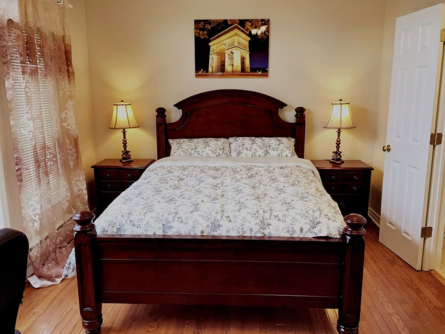 Beautiful second master bedroom ensuite with a queen size bed, sofa bed desk and bathroom.