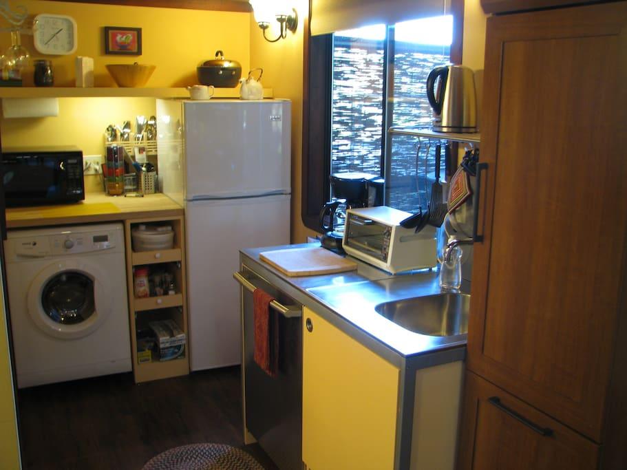 Full-size Refrigerator, Microwave Oven, European-Style Washer-Dryer, & Dishwasher.