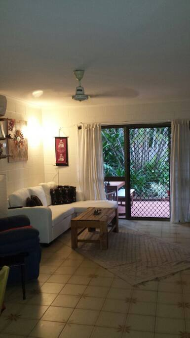 Spacious yet cosy loungeroom with large TV & aircon