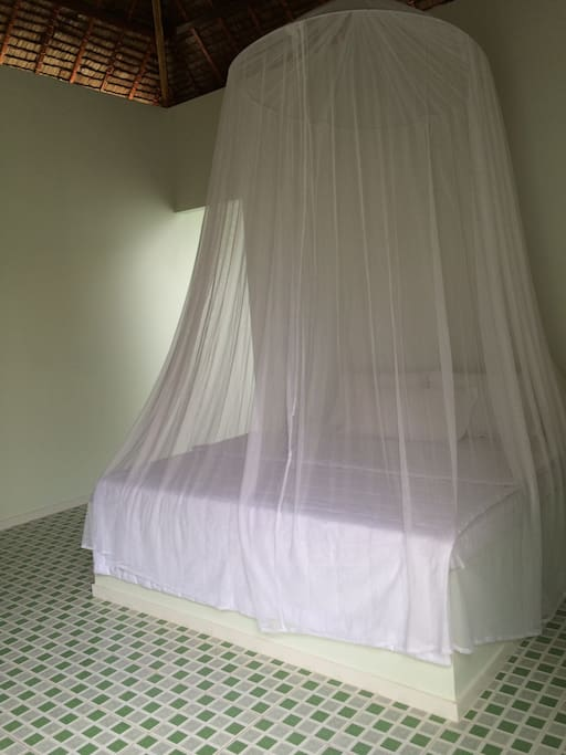 Your bungalow: bed and mosquito net