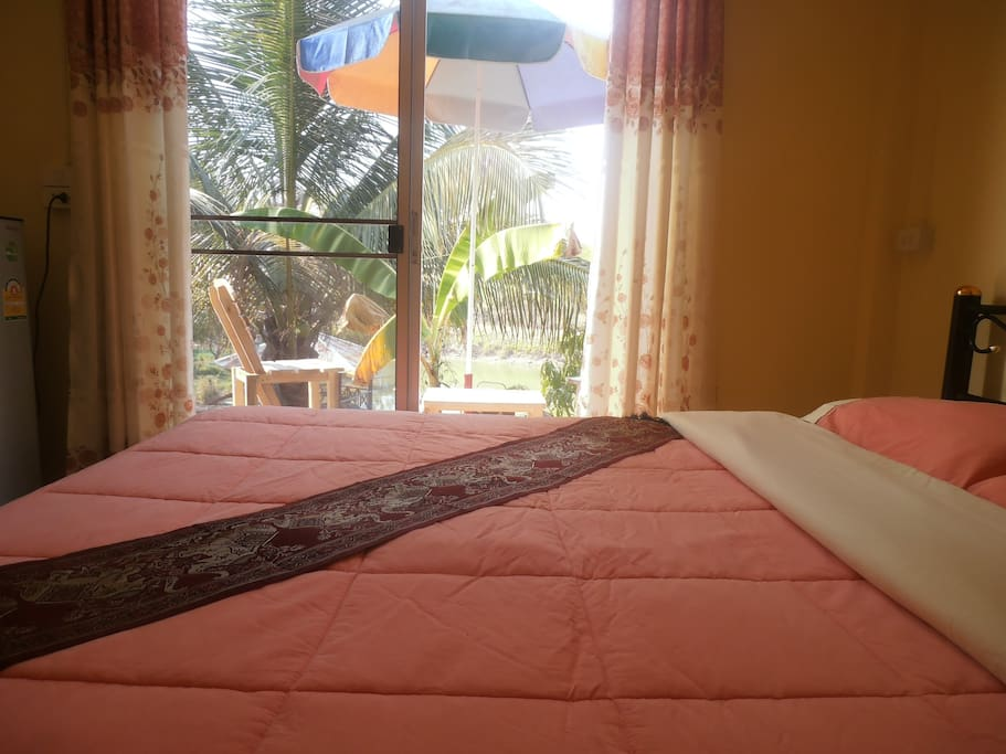the yellow room has a table 2 chairs and umbrella on your own personal veranda overlooking the lake.