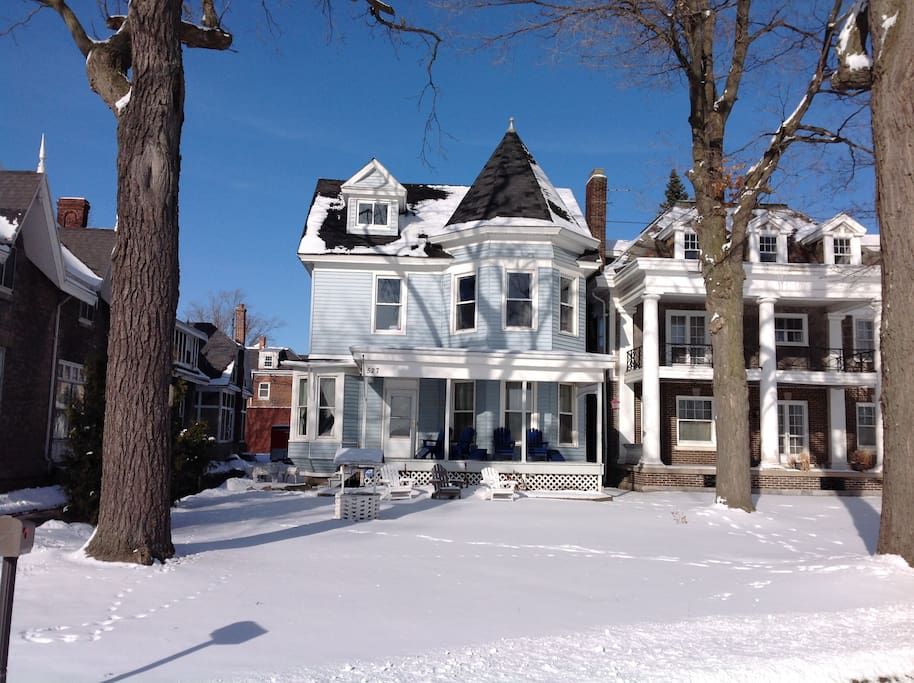 Front of our home.  Snowy Winter. Historic homes to the left and right.