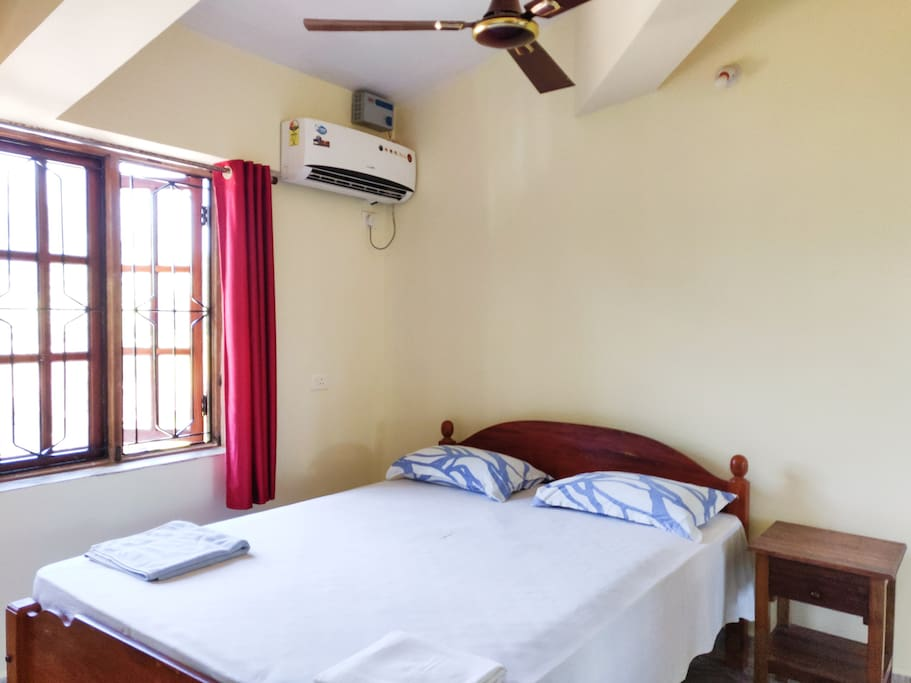 Air conditioned Bedroom with fresh bed linen