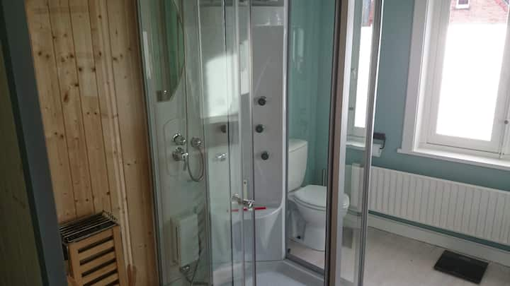 Kamer met sauna in privé badkamer en gratis fiets