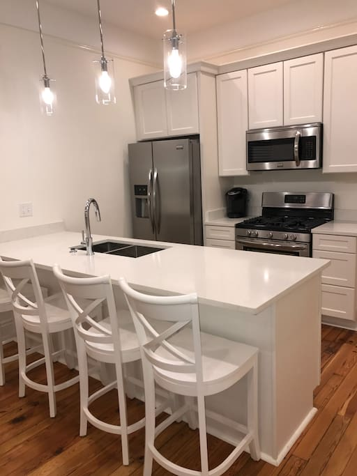 Brand new fully stocked kitchen features all new cabinets and appliances, Vicostone counters.