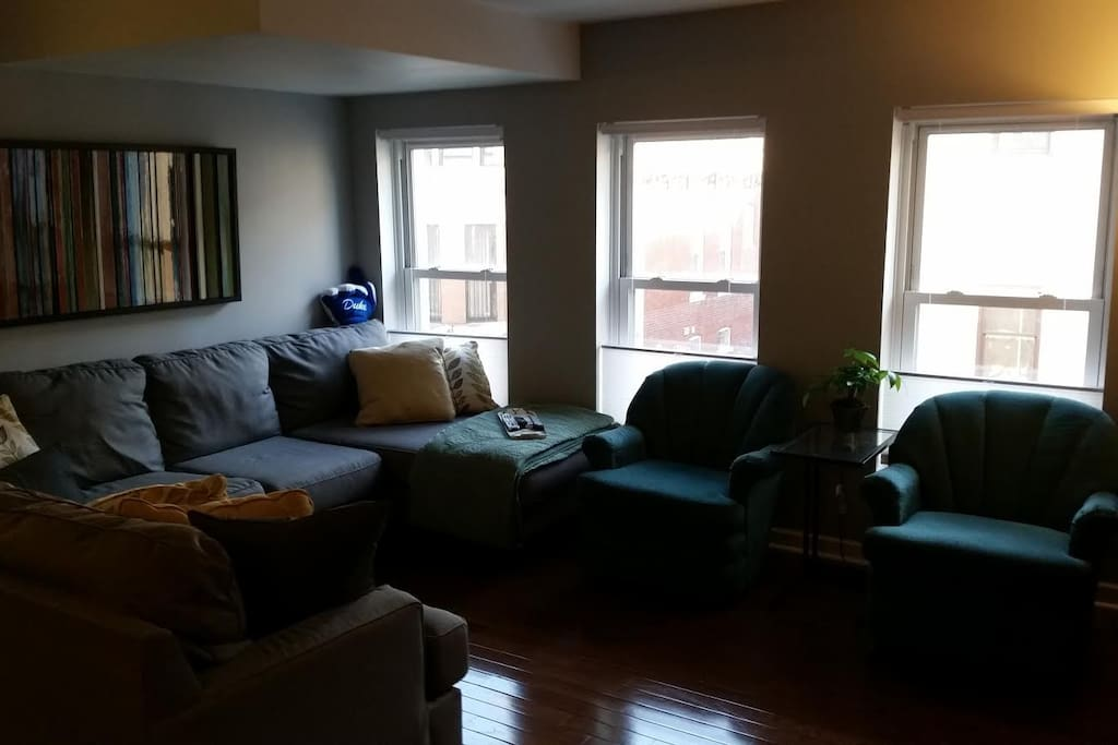 Living Room with large sectional and two chairs