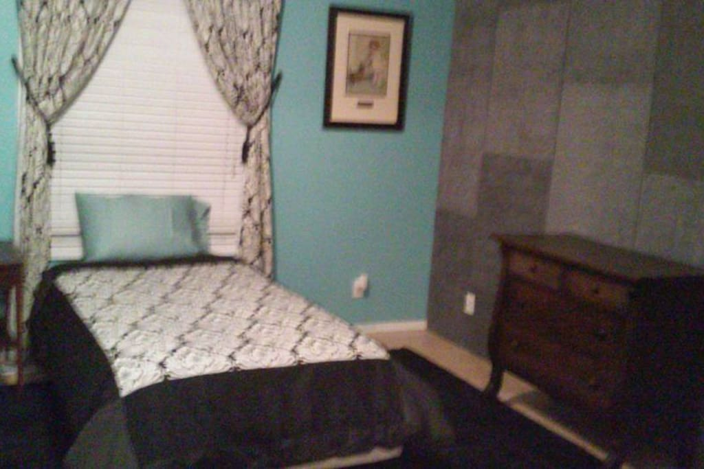 Twin bed in adjoining room with double doors that can open or close between rooms,