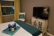 """43"""" flat screen smart TV in bedroom"""