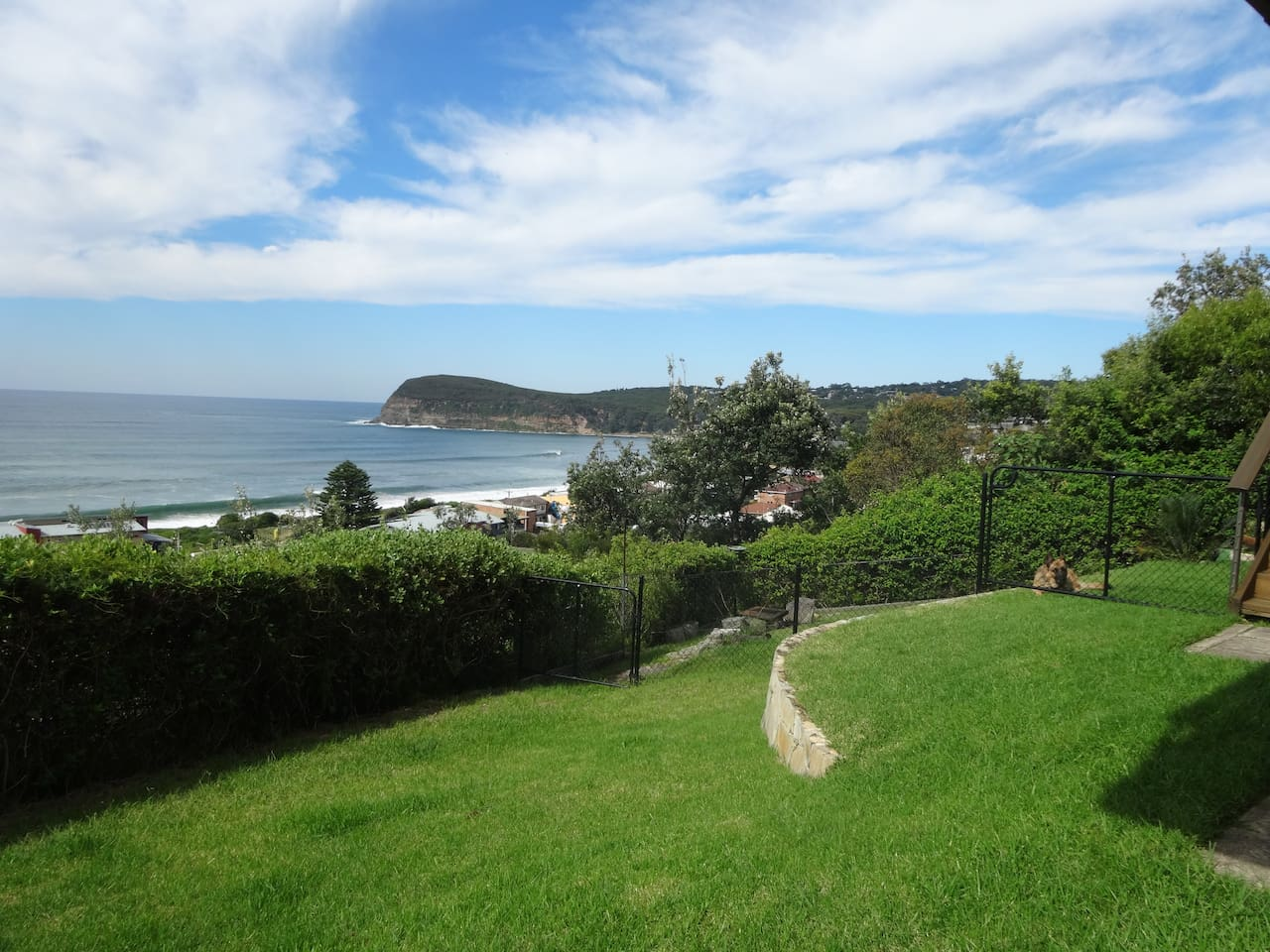 Grassed area, relax and watch the waves roll in. Great for pets.