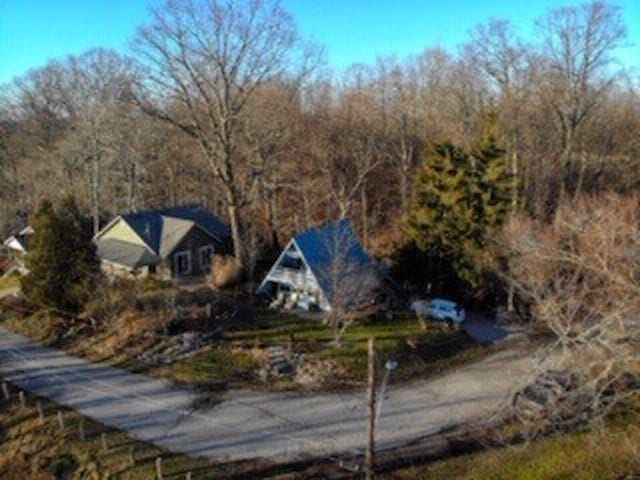 This is an aerial view of the Chalet. Parking for two vehicles in driveway.