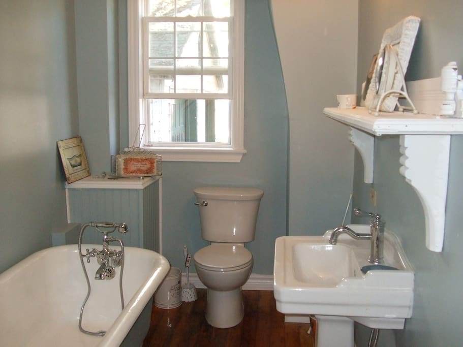 shared lower bathroom with antique clawfoot tub