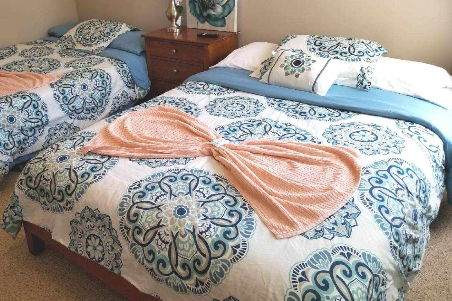Cozy Room has 2 Queen beds with brand new mattresses, 4 to 5 pillows, extra pads for comfort .  .Air conditioner to keep you cool during the summer,  heated night stand with lamp.
