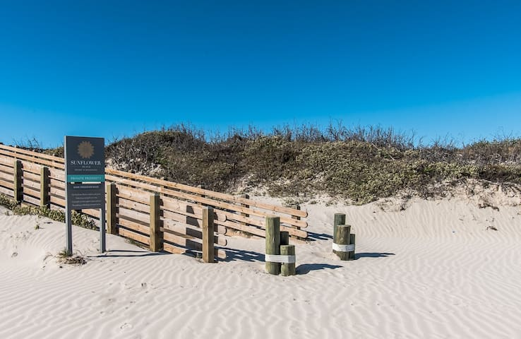 The boardwalk to the private beach can be accessed by foot or golf cart.