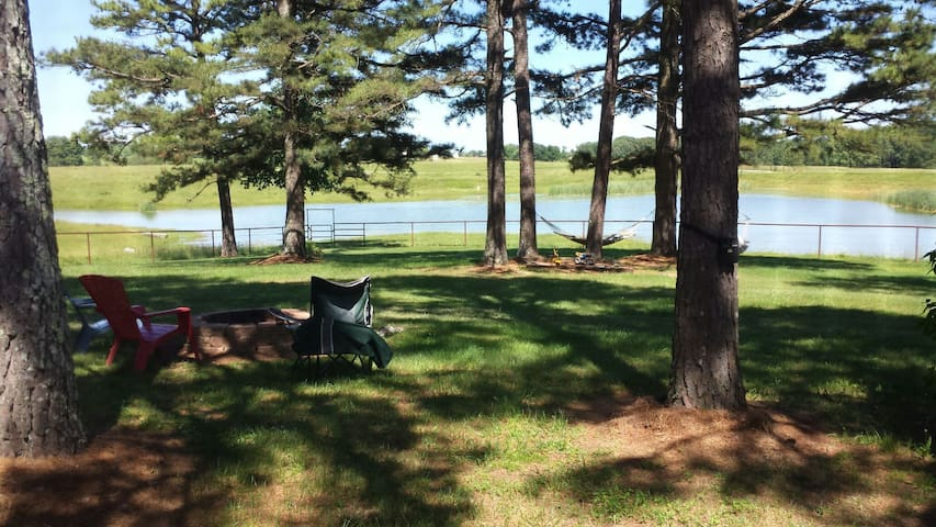 View of fishing pond from porch.   Relax in the hammock.