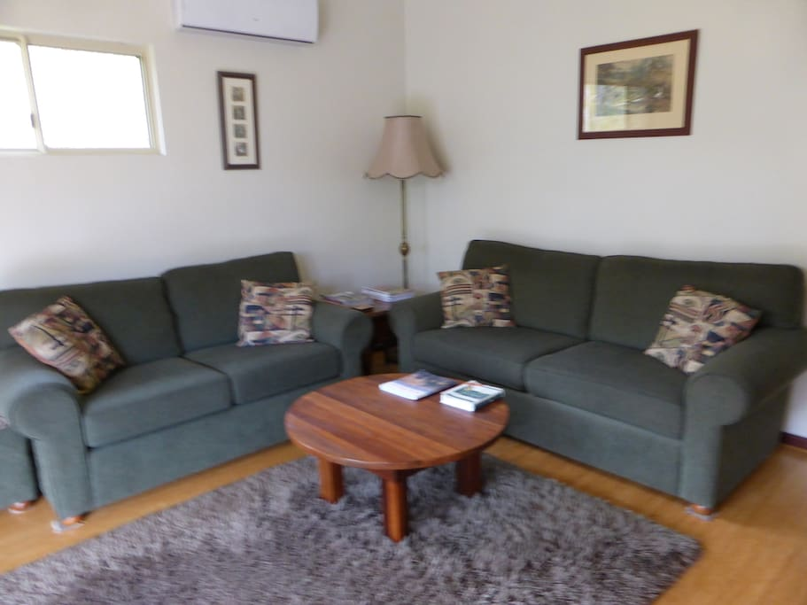 Comfortable lounge with airconditioning, log fire, TV/DVD and free WIFI.