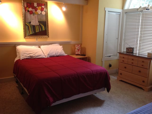 The second bedroom has a queen bed with memory foam mattress and flat screen tv.