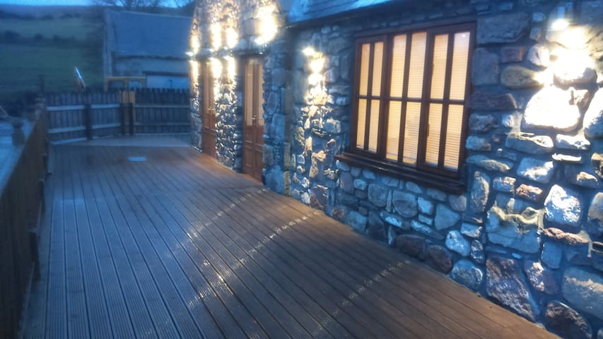 Large decking area accessible from French doors