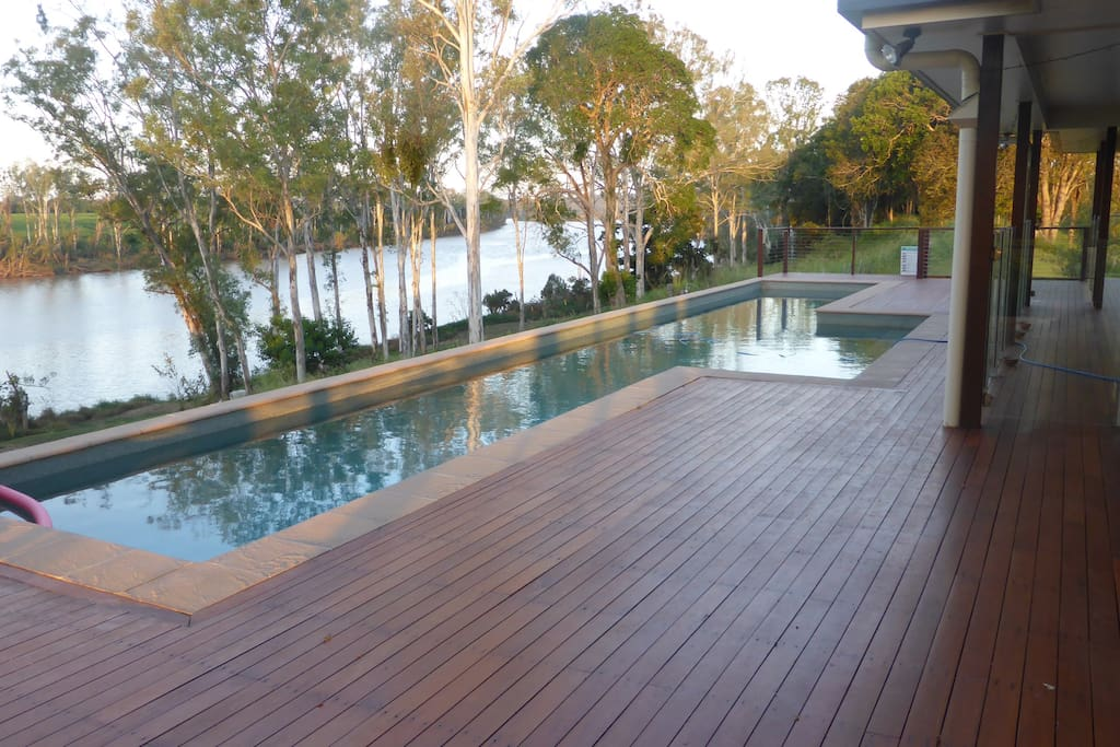 The lap pool seen with the Burnett River in the back ground is available to guests