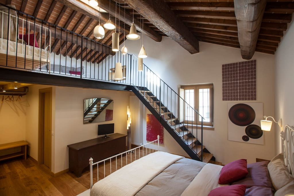 * queen size bed room with loft