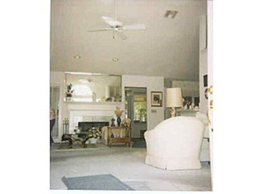 The interior of the living room from the open front door.