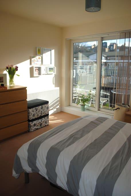 Sunny bedroom with access to balcony