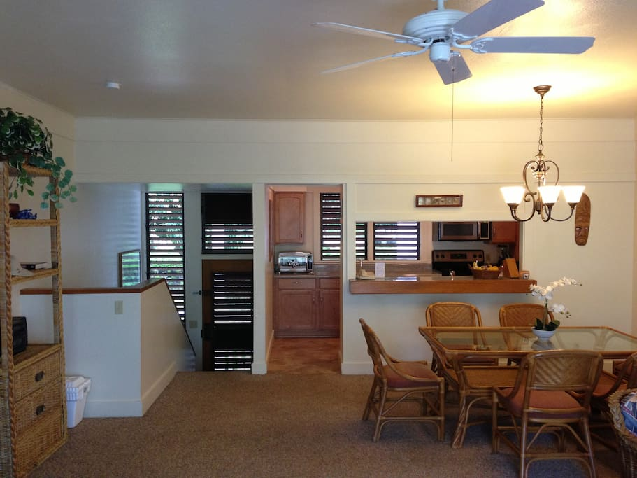 Dining room with view to kitchen and entry