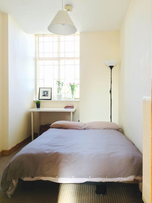 Warm and cosy room with large and comfortable bed.
